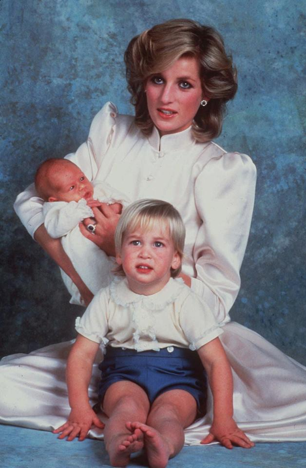 This is a 1984  photo of Princess Diana with sons Prince William, foreground, and Prince Harry.   (AP Photo)