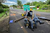 Demonstrators block the Panamerican highway between Buga and Cali as part of their protest against the government of Colombian President Ivan Duque on May 26, 2021