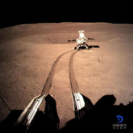 China's lunar rover Yutu-2 or Jade Rabbit 2 rolling onto the far side of the moon taken by the Chang'e-4 lunar probe is seen in this image provided by China National Space Administration
