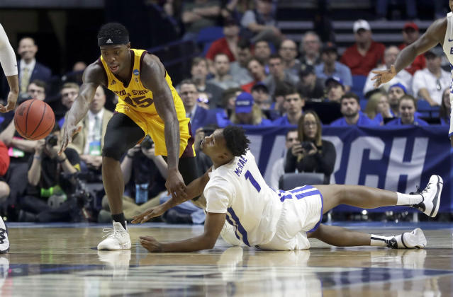 Buffalo's Montell McRae (1) and Arizona State's Zylan Cheatham (45) chase a loose ball during the first half of a first-round game in the NCAA mens college basketball tournament, Friday, March 22, 2019, in Tulsa, Okla. (AP Photo/Jeff Roberson)