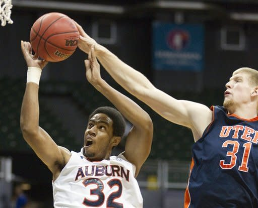 UTEP forward Cedrick Lang (31) blocks a shot by Auburn guard Noel Johnson (32) in the first half of an NCAA college basketball game Sunday, Dec. 25, 2011, in Honolulu. (AP Photo/Eugene Tanner)