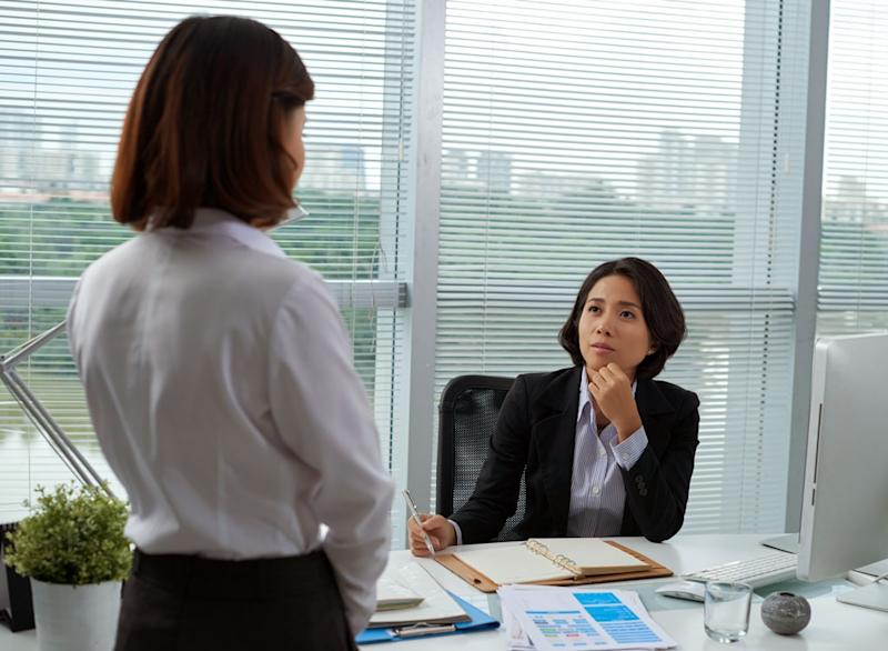 woman confronting boss about personal matter