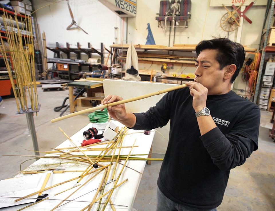 Grant Imahara tests his bamboo blowpipe in preparation for the upcoming ninja myth segment on a 2008 episode of MythBusters.
