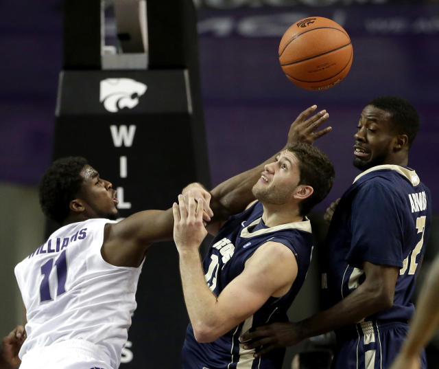 Kansas State's Nino Williams (11) chases a loose ball with George Washington's Patricio Garino, center, and Isaiah Armwood, right, during the first half of an NCAA college basketball game Tuesday, Dec. 31, 2013, in Manhattan, Kan. (AP Photo/Charlie Riedel)