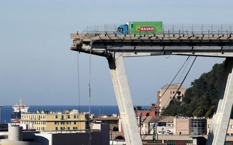 <span>A truck is perched on the remaining section of the collapsed Morandi bridge</span> <span>Credit: STEFANO RELLANDINI/ REUTERS </span>