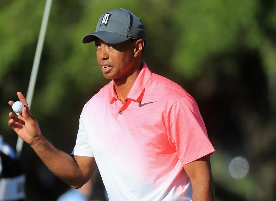 Tiger Woods opened and closed the front nine with bogeys but rallied late to shoot a level-par 72 and stand seven shots back on 140 after 36 holes at Bay Hill (AFP Photo/SAM GREENWOOD)