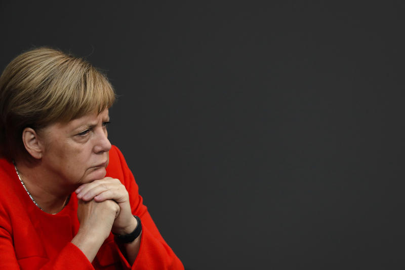 German Chancellor Angela Merkel attends a plenary session of the German parliament Bundestag about the budget 2019, in Berlin, Wednesday, Sept. 12, 2018. (AP Photo/Markus Schreiber)