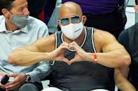 <p>Vin Diesel shows love at game 6 of the Western Conference Finals of the 2021 NBA Playoffs between the Los Angeles Clippers and Phoenix Suns at the Staples Center in L.A. on June 30.</p>