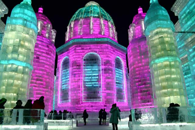 <p>Tourists enjoy spectacular ice and snow sculptures at the Harbin Ice and Snow World park in Harbin, China, on Jan. 2. (Photo: Sipa Asia/REX/Shutterstock) </p>