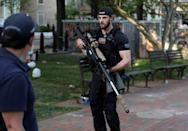 Secret Service sniper carries weapon as U.S. President Trump holds photo opportunity in front of St John's Church in Washington
