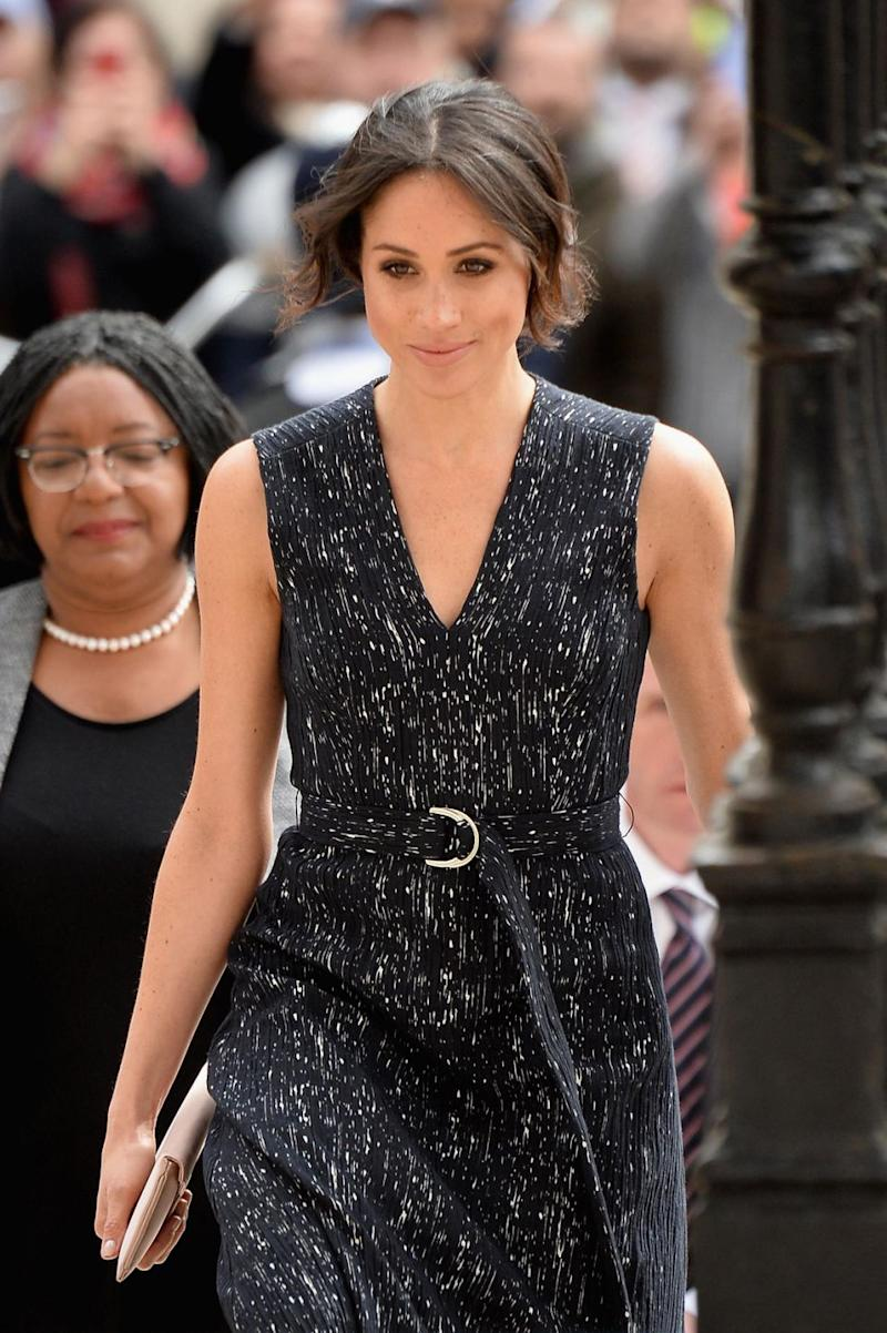 Meghan wore a sleeveless Hugo Boss dress to attend the memorial service in London. Photo: Getty