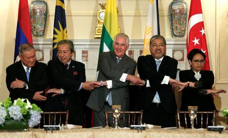 U.S. Secretary of State Rex Tillerson (C) shakes hands with ASEAN foreign ministers before a working lunch at the State Department in Washington, U.S., May 4, 2017. REUTERS/Yuri Gripas