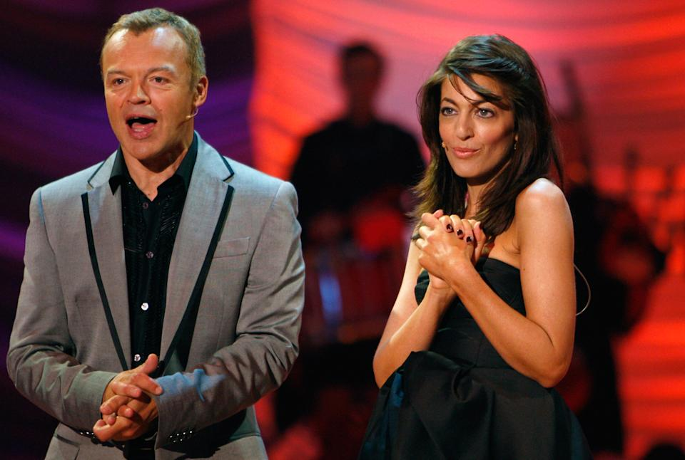 GLASGOW, UNITED KINGDOM - SEPTEMBER 05:  Television presenters Claudia Winkleman (R) and Graham Norton host the Eurovision dance contest dress rehearsal September 5, 2008 in Glasgow, Scotland. Twenty-eight dancers from 14 countries are being represented in the show, which will be televised live on BBC1 tomorrow.   (Photo by Jeff J Mitchell/Getty Images)