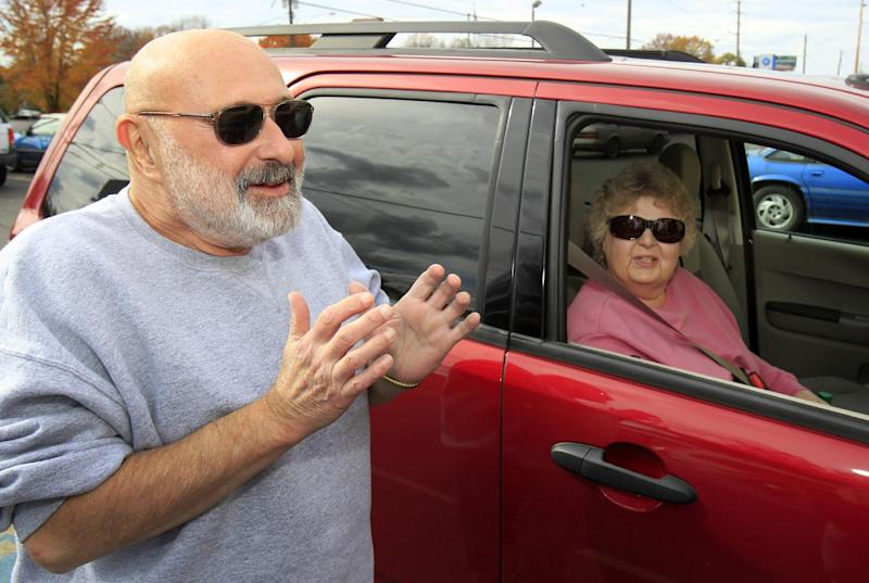 This photo taken Oct. 19, 2012 shows General Motors retiree George Vukovich, and his wife Nancy, discussing politics after voting at the Trumbull County Board of Elections in Warren, Ohio. President Barack Obama's decision to help America's automakers could end up being what helps drive him back into the White House. Some 850,000 jobs in this critical battleground state are tied to autos and Obama's campaign constantly reminds voters they'd be jobless if not for the decision to inject taxpayer dollars into General Motors and Chrysler. (AP Photo/Tony Dejak)