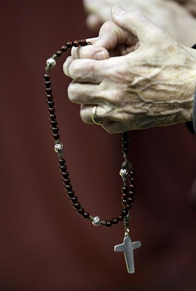 Sister Grace Anne, of Penance of the Sorrowful Mother, prays at Republican presidential candidate, former Pennsylvania Sen. Rick Santorum's Election Night Party at Steubenville High School, Tuesday, March 6, 2012, in Steubenville, Ohio. (AP Photo/Eric Gay)