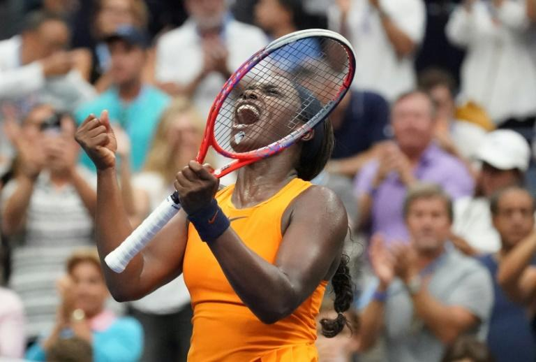 Match point: Defending champion Sloane Stephens celebrates US Open third-round victory over Victoria Azarenka on Friday