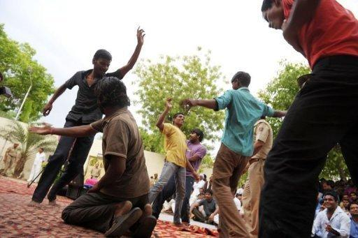 Inmates dance in front of other prisoners to live music during a small concert at the Tihar jail in New Delhi. Tihar jail has a record of innovative rehabilitation schemes for prisoners including yoga, meditation, art classes and a shop selling products made by inmates
