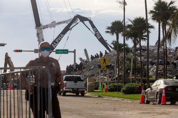 PHOTO: Rescue workers continue working on a pile of debris on July 5, 2021 after the partially collapsed Champlain Towers South condo was taken down in Surfside, Fla. The building was taken down due to possible impact of approaching Tropical Storm Elsa.  (Saul Martinez/Getty Images)