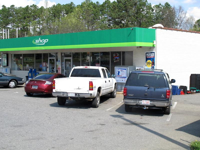 Several cars with North Carolina license plates are parked at the Lake Wylie Minimart in Lake Wylie, S.C. on Wednesday, March 21, 2012. The store's owner thought his business was in South Carolina, but surveyors have determined it is actually in North Carolina, meaning his gas prices will likely go up 30 cents and he can't sell fireworks. (AP Photo/Jeffrey Collins)