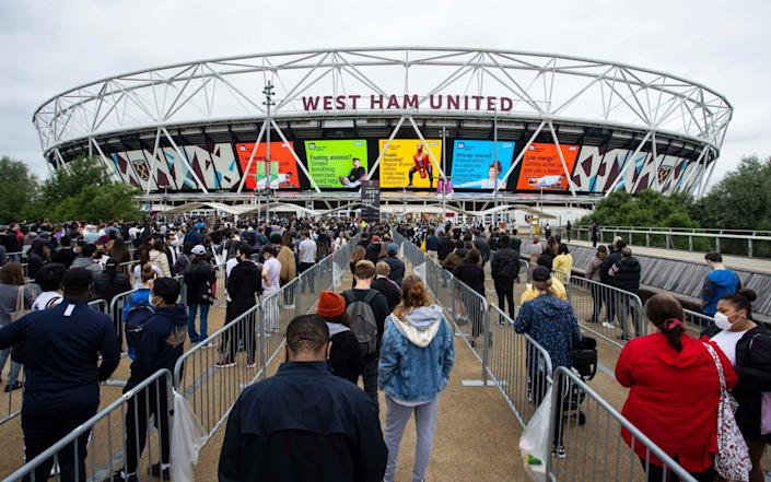 Thousands are queuing up for vaccines at 'super pop-up' stadiums with Indian/delta variant cases rising - Jamie Lorriman