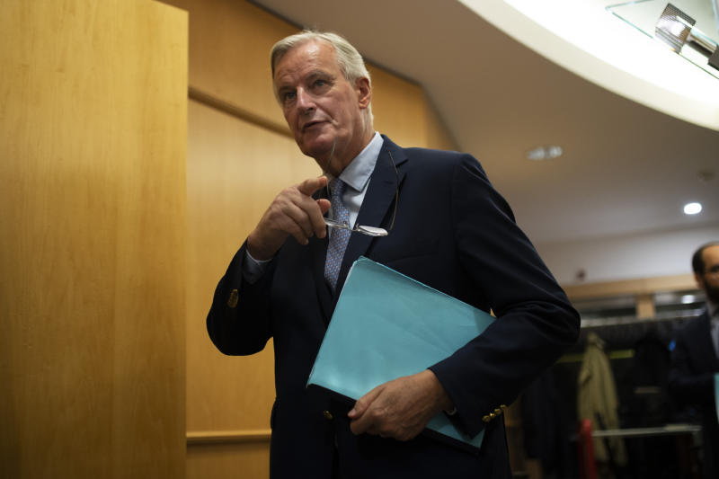 European Union chief Brexit negotiator Michel Barnier arrives to a conference of presidents meeting at the European Parliament in Brussels, Thursday, Sept. 12, 2019. Barnier says the bloc is still waiting for proposals from Prime Minister Boris Johnson to end the impasse in talks over Britain's departure, due at the end of next month. (AP Photo/Francisco Seco)