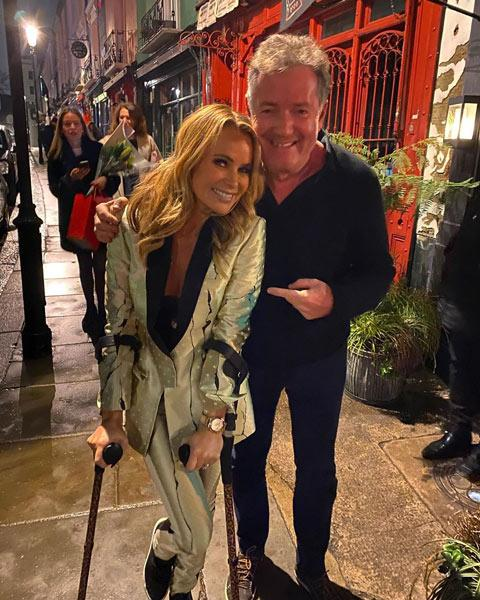 Amanda Holden's suit is a winner with Instagram fans as she parties with Piers Morgan