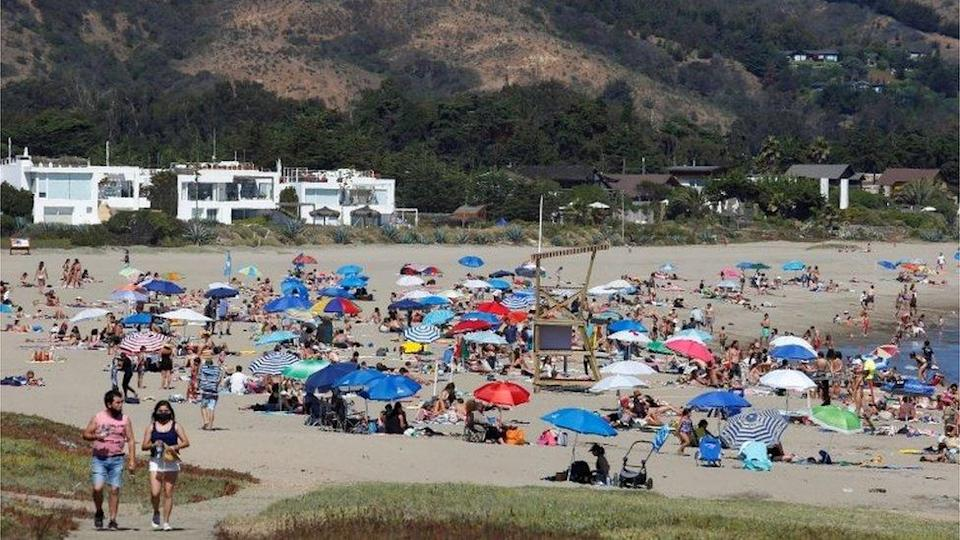 People spend the day at the Cachagua beach during the outbreak of the coronavirus disease (COVID-19) in Zapallar, Chile February 8, 2021.