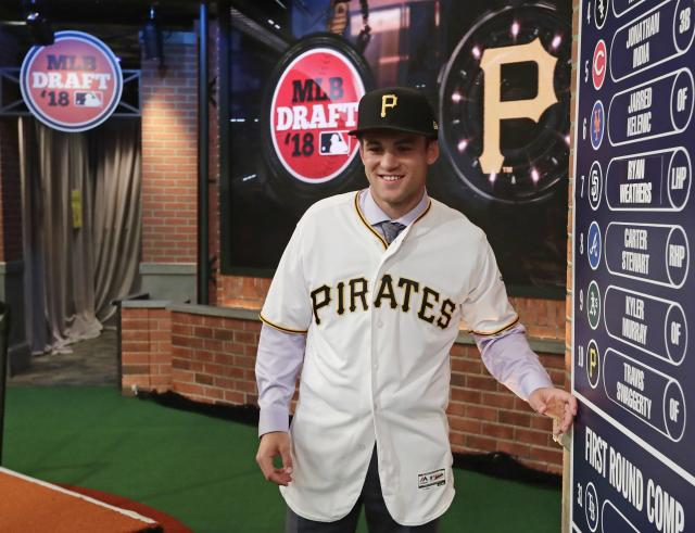 Loved ones watch as Travis Swaggerty, an outfielder from University of South Alabama, poses for photos after being selected tenth during the first round of the Major League Baseball draft Monday, June 4, 2018, in Secaucus, N.J. (AP Photo/Frank Franklin II)