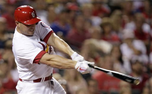 St. Louis Cardinals' Matt Holliday connects for a solo home run in the sixth inning of a baseball game against the Chicago Cubs, Thursday, June 20, 2013, in St. Louis.(AP Photo/Tom Gannam)
