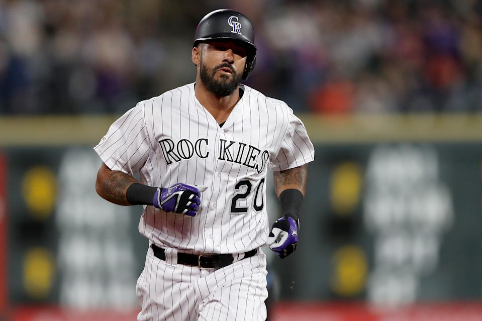 Ian Desmond in white Rockies uniform.