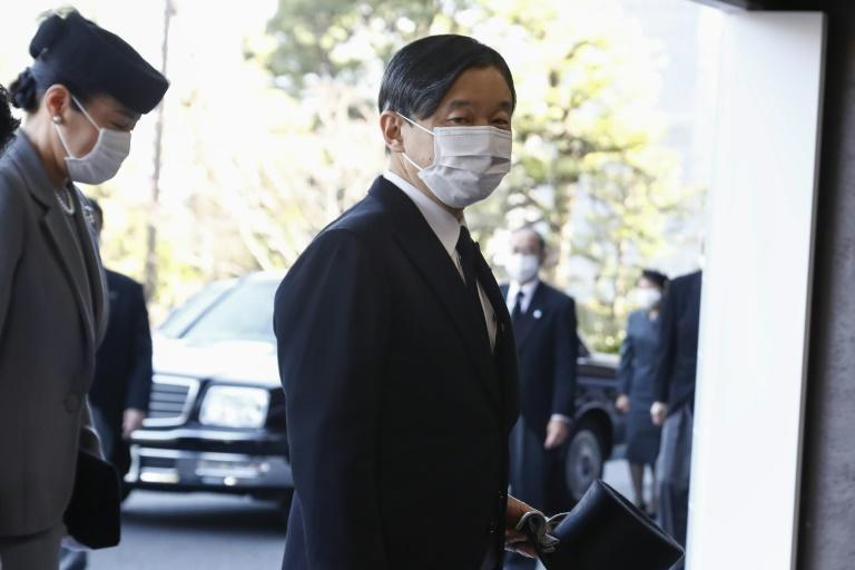 Japanese Emperor Naruhito (R) is an important symbolic figure in Japan