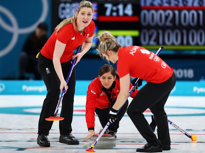 Eve Muirhead, centre, was penalised with Britain's final stone: Getty Images