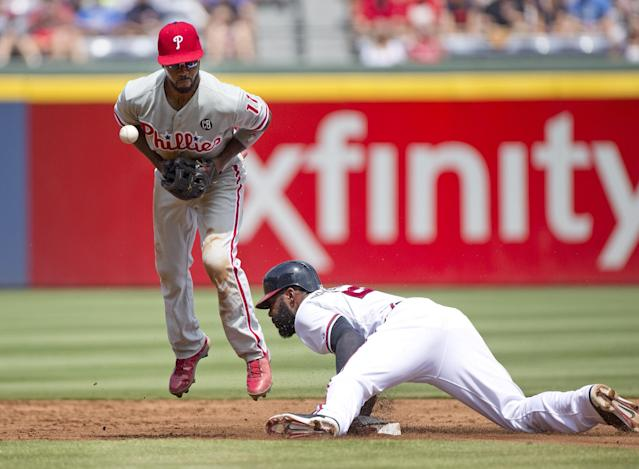 Atlanta Braves' Jason Heyward steals second base as Philadelphia Phillies shortstop Jimmy Rollins (11) handles the late throw in the first inning of a baseball game Monday, Sept. 1, 2014, in Atlanta. (AP Photo/John Bazemore)