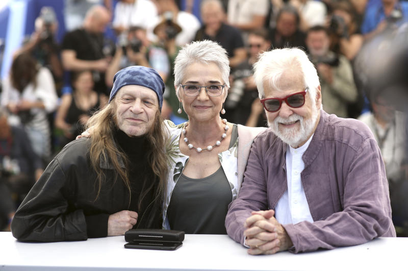 Actor Leon Vitali, from left, Katharina Kubrick and producer Jan Harlan pose for photographers at the photo call for the film 'The Shining' at the 72nd international film festival, Cannes, southern France, Thursday, May 16, 2019. (AP Photo/Petros Giannakouris)