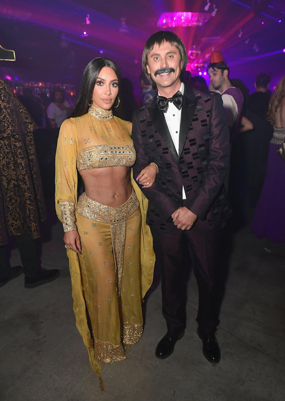 "<p>Jonathan Cheban and <a class=""link rapid-noclick-resp"" href=""https://www.popsugar.com/Kim-Kardashian"" rel=""nofollow noopener"" target=""_blank"" data-ylk=""slk:Kim Kardashian"">Kim Kardashian</a> dressed as Sonny and Cher for the Casamigos <a class=""link rapid-noclick-resp"" href=""https://www.popsugar.com/Halloween"" rel=""nofollow noopener"" target=""_blank"" data-ylk=""slk:Halloween"">Halloween</a> Party in 2017, and their looks were spot on.</p>"