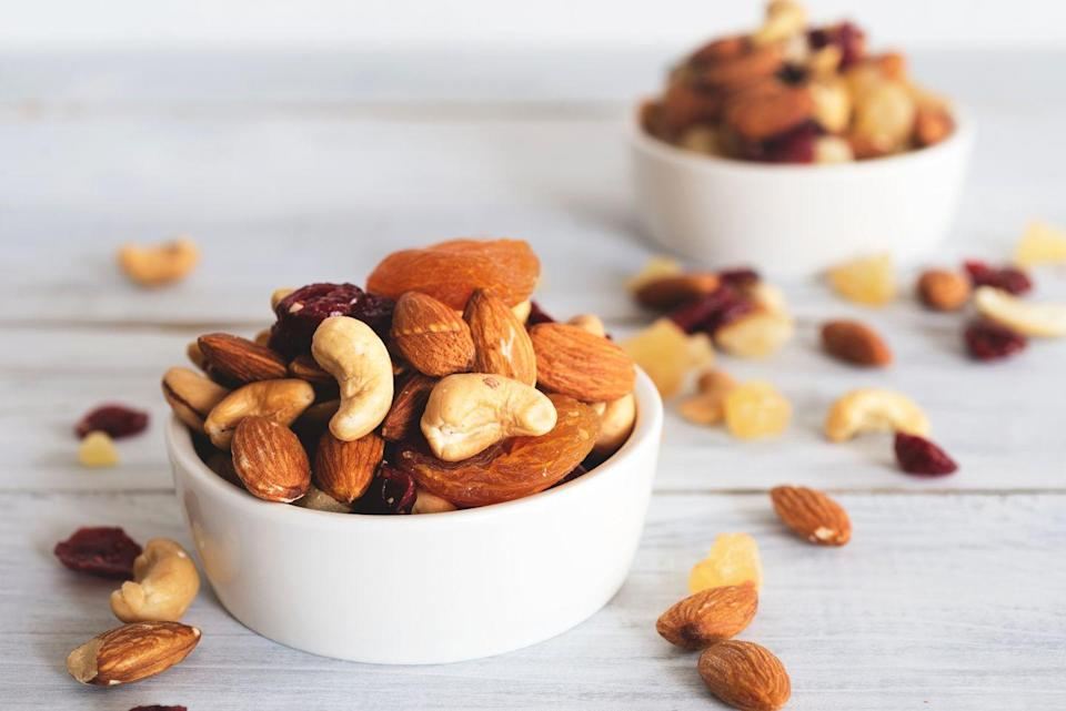 """<p>Nuts make a filling <a href=""""https://www.prevention.com/weight-loss/g19576831/healthy-snack-ideas-weight-loss/"""" rel=""""nofollow noopener"""" target=""""_blank"""" data-ylk=""""slk:snack that promotes weight loss"""" class=""""link rapid-noclick-resp"""">snack that promotes weight loss</a> because they're high in fiber, healthy fats, and protein. Bonus: The nutrients in nuts help reduce your risk of chronic conditions, like <a href=""""https://www.prevention.com/health/health-conditions/a21764231/type-2-diabetes-definition/"""" rel=""""nofollow noopener"""" target=""""_blank"""" data-ylk=""""slk:diabetes"""" class=""""link rapid-noclick-resp"""">diabetes</a> and <a href=""""https://www.prevention.com/health/health-conditions/g26253924/weird-heart-disease-risk-factors/"""" rel=""""nofollow noopener"""" target=""""_blank"""" data-ylk=""""slk:heart disease"""" class=""""link rapid-noclick-resp"""">heart disease</a>, says Mirkin.</p><p><strong>Try it:</strong> These <a href=""""https://www.prevention.com/food-nutrition/recipes/a22998801/cherry-chocolate-granola-bars-recipe/"""" rel=""""nofollow noopener"""" target=""""_blank"""" data-ylk=""""slk:cherry chocolate granola bars"""" class=""""link rapid-noclick-resp"""">cherry chocolate granola bars</a> pack a double dose of nuts with almond butter and chopped almonds.</p>"""