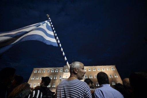 Greek police use teargas, protesters throw petrol bombs