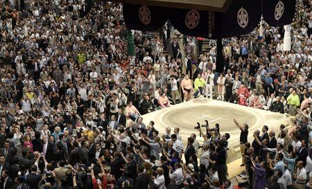 People take photos of U.S. President Donald Trump during the final day of the Summer Grand Sumo Tournament at Ryogoku Kokugikan in Tokyo, Japan May 26, 2019,  in this photo taken by Kyodo. Mandatory credit Kyodo/via REUTERS