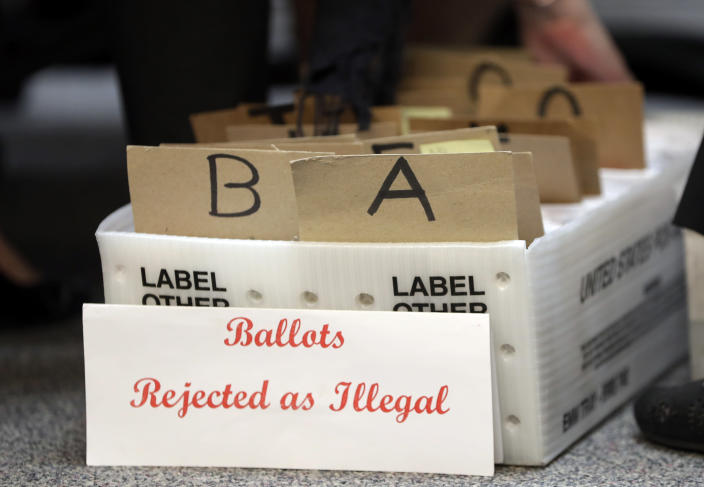 <p>Rejected mail in ballots sit in a box as members of the canvassing board verify signatures on ballots at the Miami-Dade County Elections Department, in Miami, Fla., Oct. 30, 2018. Voters go to the polls in the midterm elections Nov. 6. Long lines, broken voting machines and poll worker confusion are all common at polling places across the country on Election Day. With more people voting early, some of these issues are already popping up in this year'€™s midterm election. (Photo: Lynne Sladky/AP) </p>