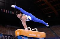 <p>TOKYO, JAPAN - JULY 28: Takeru Kitazono of Team Japan competes on pommel horse during the Men's All-Around Final on day five of the Tokyo 2020 Olympic Games at Ariake Gymnastics Centre on July 28, 2021 in Tokyo, Japan. (Photo by Laurence Griffiths/Getty Images)</p>