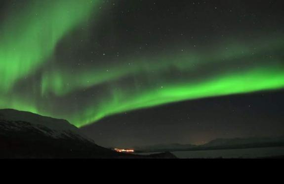 """Photographer Chad Blakley snapped this view of the northern lights over Abisko National Park in northern Sweden. The photo is a still from a video Blakley created called """"Lights Over Lapland."""""""