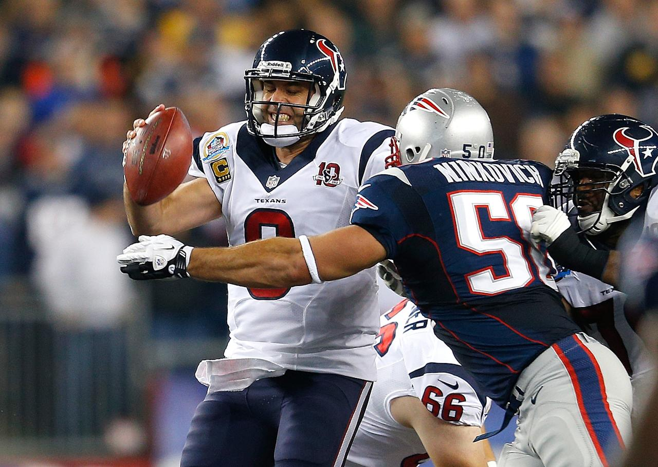 FOXBORO, MA - DECEMBER 10:  Matt Schaub #8 of the Houston Texans is chased by Rob Ninkovich #50 of the New England Patriots in the first half at Gillette Stadium on December 10, 2012 in Foxboro, Massachusetts. (Photo by Jim Rogash/Getty Images)