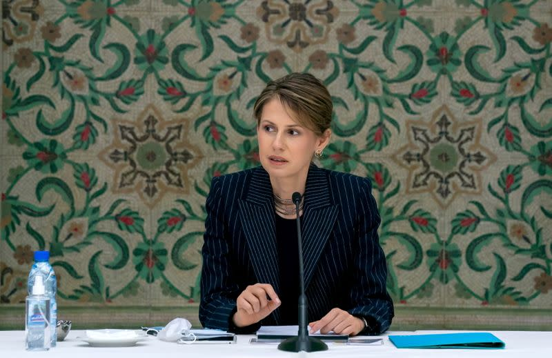 FILE PHOTO: Asma Assad, wife of Syrian President Bashar al-Assad, meets with humanitarian and business groups in Damascus