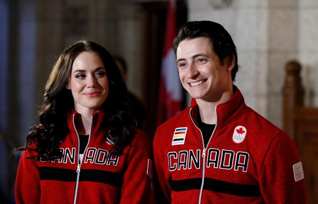 Ice dancers Tessa Virtue and Scott Moir react while being named Canada's flag-bearers for the opening ceremony of the 2018 Pyeongchang Winter Olympic Games during an event on Parliament Hill in Ottawa, Ontario, Canada, January 16, 2018. REUTERS/Chris Wattie