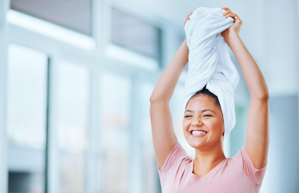 """<h1 class=""""title"""">Shot of a young woman drying her hair with a towel</h1> <cite class=""""credit"""">Getty Images</cite>"""