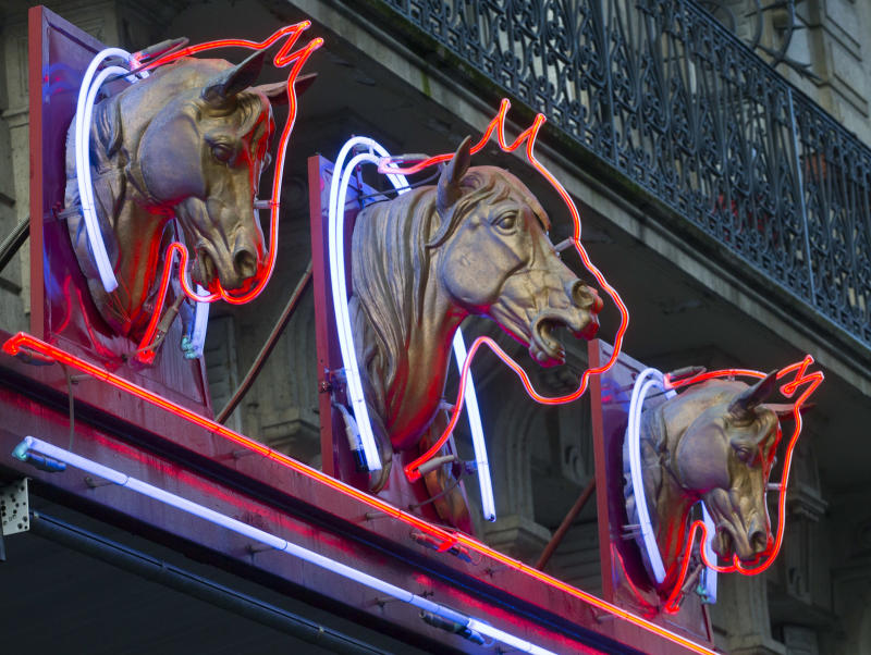 3 statues of horses' heads,  above a horsemeat butcher shop  in Paris, Friday Feb 15, 2013.  Tests have found horsemeat in school meals, hospital food and restaurant dishes in Britain, officials said Friday, as the scandal over adulterated meat spread beyond frozen supermarket products. French French Consumer Affairs Minister Benoit Hamon said Thursday that it appeared fraudulent meat sales over several months reached across 13 countries and 28 companies. He identified French meat wholesaler Spanghero as a major culprit. (AP Photo/Jacques Brinon)