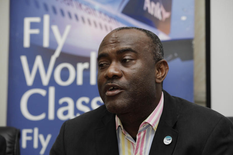 Chris Ndulue, Managing Director of Arik airline speaks to journalist during a press conference in Lagos, Nigeria. Saturday, Sept. 22, 2012.  Nigeria's largest airline says it will resume flights Sunday after halting them over what it claimed was government corruption strangling its business.  Ndulue told journalists Saturday that the airline had meetings with government officials and had resolved its differences, without giving specifics. (AP Photo/Sunday Alamba)