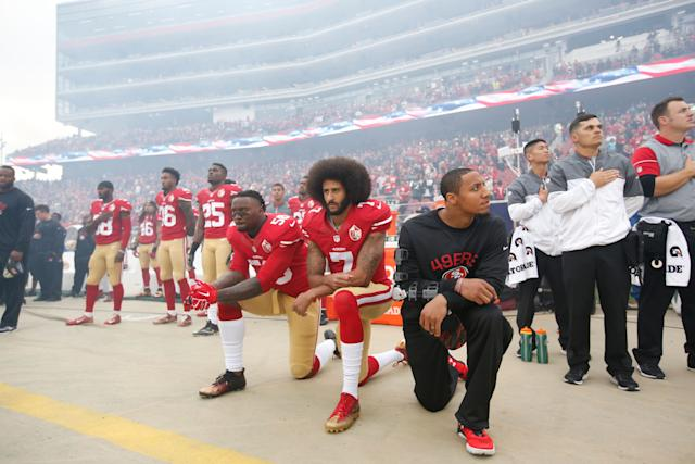 From left to right, Eli Harold, Colin Kaepernick and Eric Reid of the San Francisco 49ers kneel during the national anthem on Dec. 11, 2016, in Santa Clara, California.