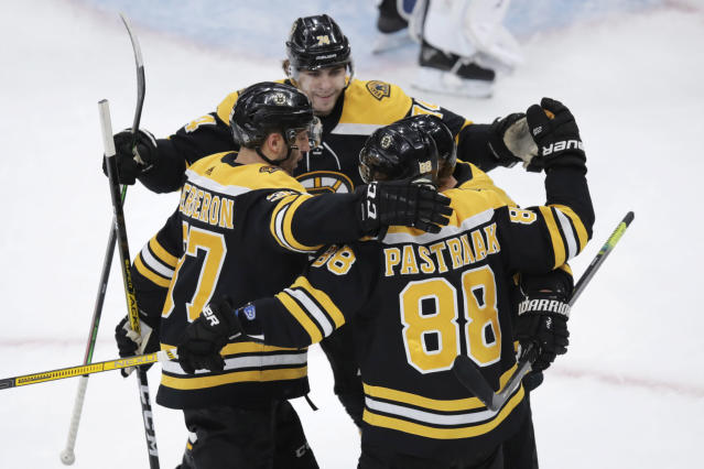 Boston Bruins right wing David Pastrnak (88) is congratulated after his goal against the Toronto Maple Leafs during the first period of an NHL hockey game in Boston, Tuesday, Oct. 22, 2019. (AP Photo/Charles Krupa)