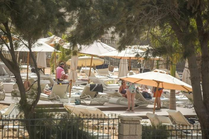 Some tourists made the most of the shutdown to sunbathe by the pool (AFP Photo/DESIREE MARTIN)